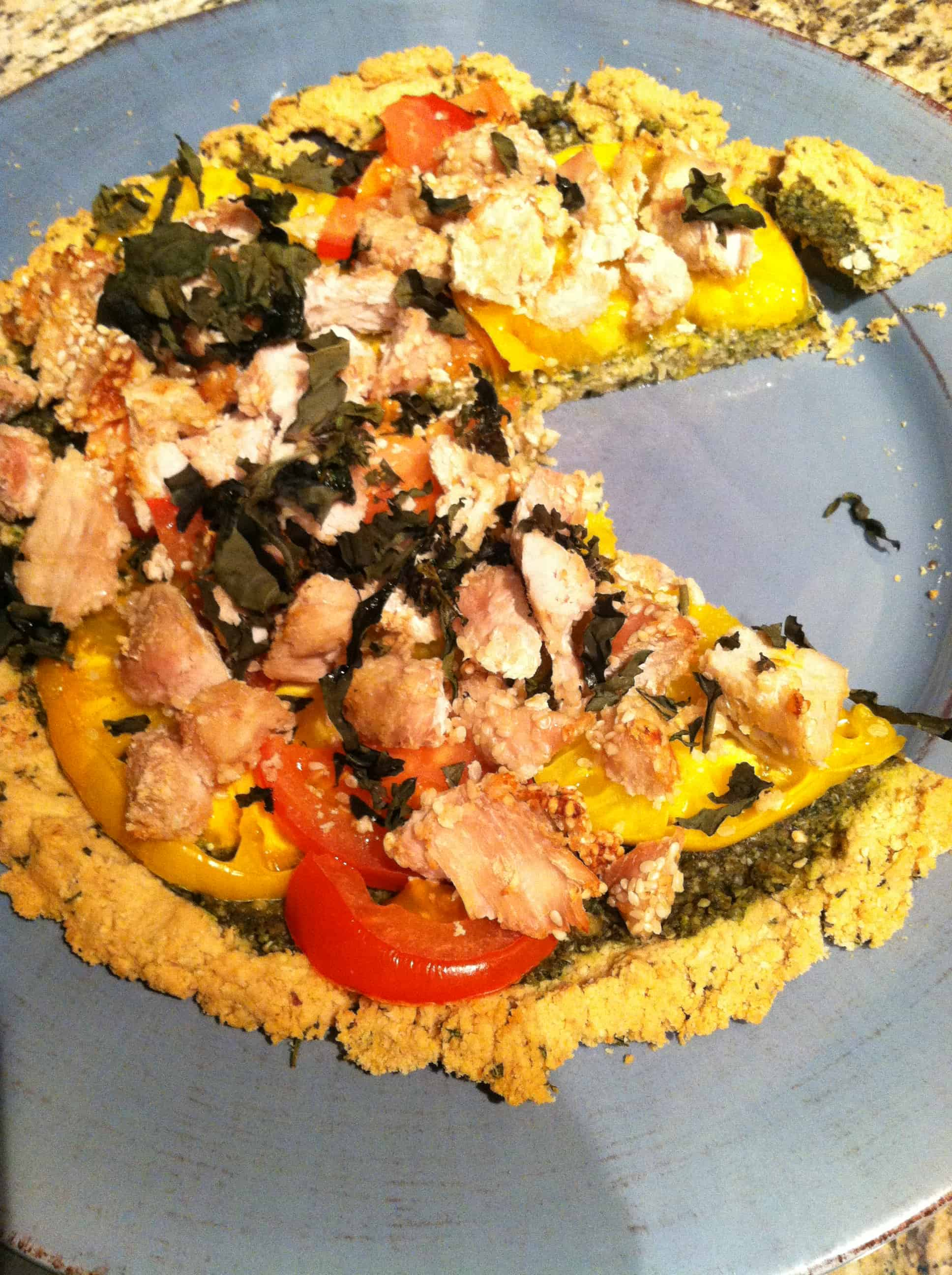 Easy Gluten-Free Herbed Pizza Crust topped with Sesame Turkey Bites, Pesto and Fresh Tomatoes (Paleo)