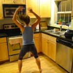 jumping jacks! You don't have to sit around while waiting for your water to boil. Get your body moving simply by doing some jumping jacks. Tighten your abs to bring your pelvis forward and take the curve out of your lower back.