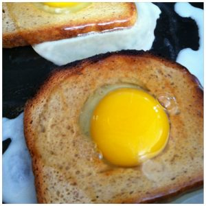 Crack the eggs into the hole