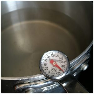 2. Add 1 T vinegar and 1 T salt to a pot of water. Bring it to 200 degrees F and turn off the heat.