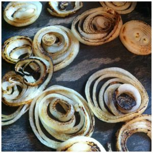 4. Grill or sear onions in a little olive oil until browned.