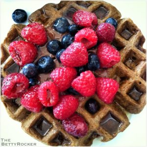 Dollop of Nutella in the center, fresh blueberries and raspberries then a drizzle of maple syrup.