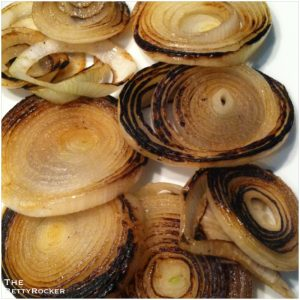 2. While the eggplant is baking, grill or pan sear your onion slices until crispy and translucent.