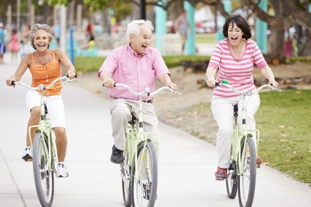 42314787 - group of senior friends having fun on bicycle ride